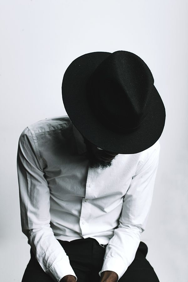 STREET ETIQUETTE Stylish look white shirt and a black hat Men style