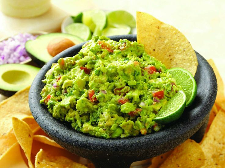 You don't need a special occasion to make this very simple Guacamole. This mild guacamole can be customized easily to suit a variety of tastes. Place small bowls of chopped jalapeño or serrano chiles, cilantro, garlic, tomato, onion, and seasonings around the guacamole bowl and let everyone build their own perfect dip. Ingredients 4 ripe, …