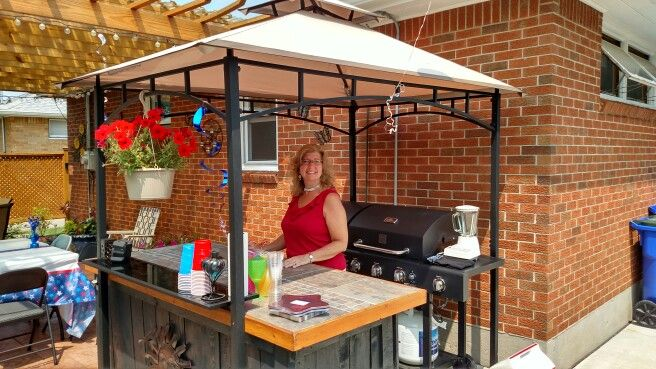 Covered the grill and the island with a cheap grill gazebo from Walmart and it looks great. Drilled a couple holes in the gazebo legs and screwed it to the bar so it wont blow away. Really nice set up for not a lot of money.