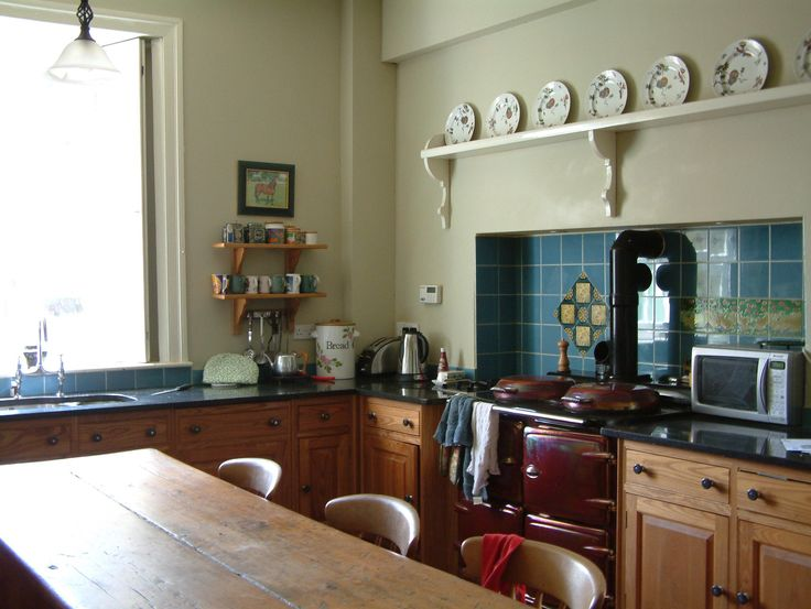 This Original Victorian Kitchen With Glass Window And Wooden Table And Wooden Cabinet Great