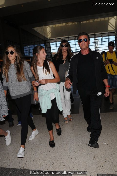 Sylvester Stallone and family at Los Angeles International Airport (LAX) http://icelebz.com/events/sylvester_stallone_and_family_at_los_angeles_international_airport_lax_/photo2.html