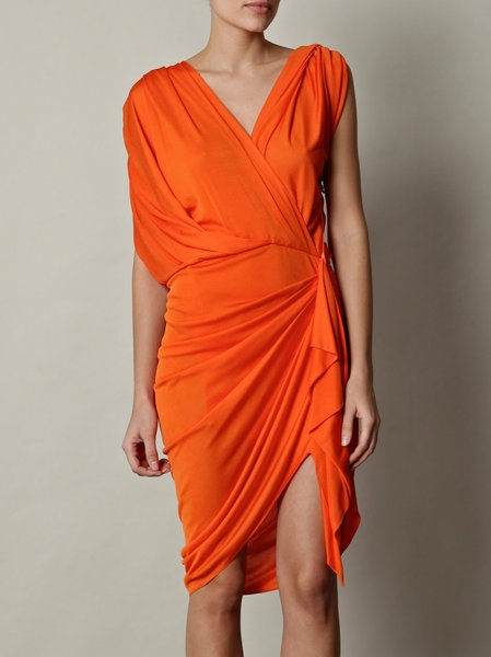 If you can pull it off without looking like a pumpkin, orange is a great color to wear because people generally avoid it.  Strangely enough, dresses that vaguely look as if you've randomly thrown a sheet over you and called it a costume tend to be very flattering for rhythm dancing.
