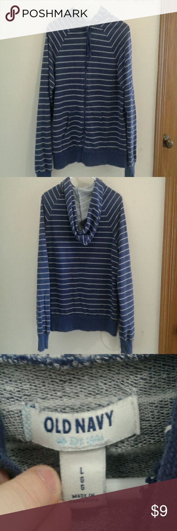 Womens Zipper and Hooded Sweatshirt Navy Blue and White Striped.  L.  Old Navy.  Worn, but fair condition.  Faded, but that is how it was when bought brand new.  Picked inside on back.  Left arm seem has a spot that is coming undone.  I do not have to know how to sew.  Sure it is an easy fix.  Smoke free home. Old Navy Tops Sweatshirts & Hoodies