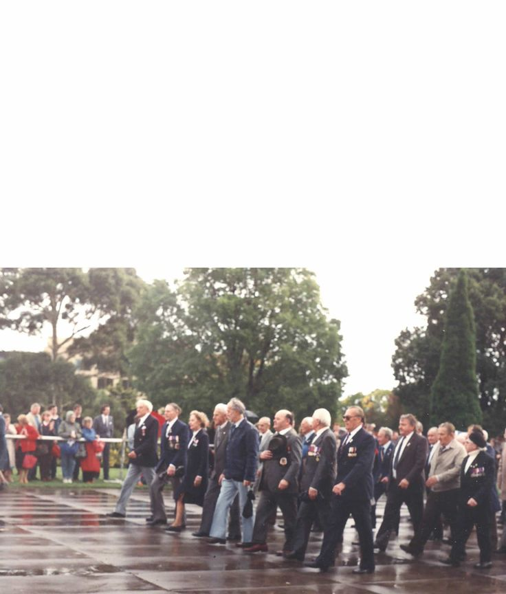 Anzac day march.Front row centre.A wet day for the polak's even wetter after the march at the Polish RSL.Cheers.