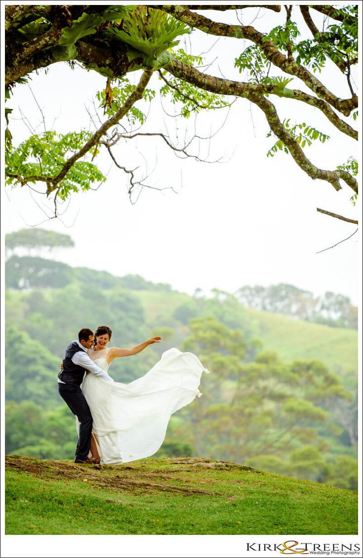 groom hugging bride under the Maleny Manor tree