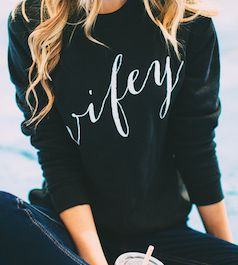 Love this black wifey sweater