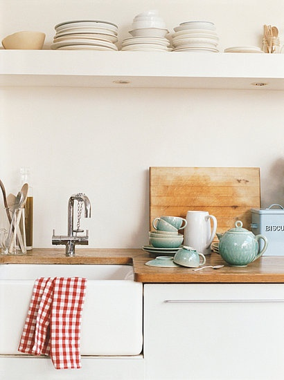 butcher block & farmhouse sink. no upper cabinets. just picture a long modern window on that wall with a high shelf overhead for all the ball jars, etc.