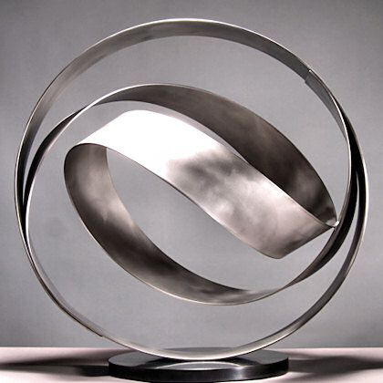 Patinaed stainless steel orb | Artist: Damon Hyldreth | KNOT series. Thanks to Kan Wei original pin.