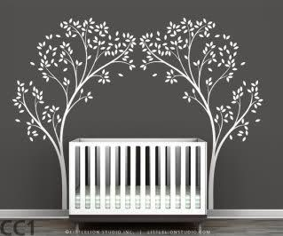 Pretty trees arching over crib.