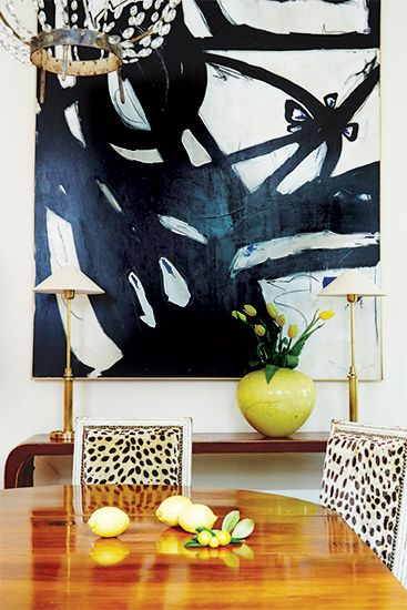 Bold black and white abstract art Leopard print upholstered french chairs  Crystal chandelier