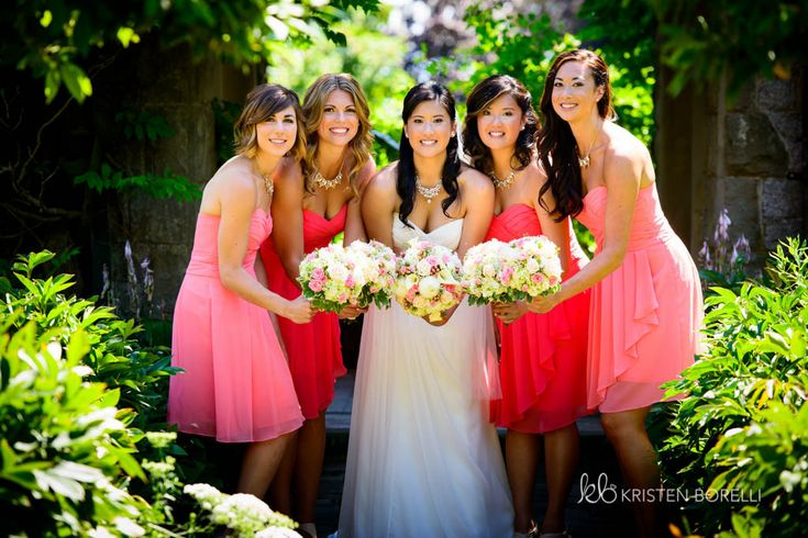 Bridesmaids wearing light pink and dark pink. Two different shades of bridesmaid dresses.  (Kristen Borelli Photography, Victoria Wedding Photography, Hatley Castle Wedding Photography, Destination Wedding Photographer, Victoria Wedding Photographer, Hatley Castle Wedding Photographer, Nanaimo Wedding Photographer, Vancouver Island Wedding Photographer, Vancouver Island Wedding Photography, Prince George Wedding Photographer)