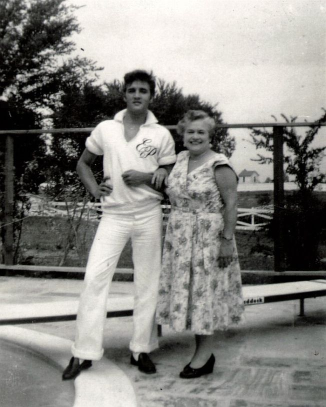 "Memphis, TN, Friday August 9, 1957: Actor Nick Adams (""Rebel Without a Cause"") and his mother, Catherine Adamshock (née Kutz, April 17, 1910 – March 1995), visit Elvis and his parents at Graceland. Elvis wearing his monogrammed shirt and Nick's mom are pictured by the pool."