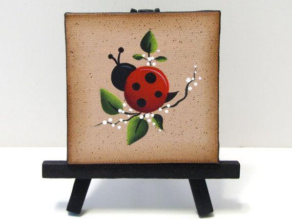 Ladybug Mini Canvas on Easel, Handpainted, Home Decor,  Shelf Sitter. $8,95, via Etsy.