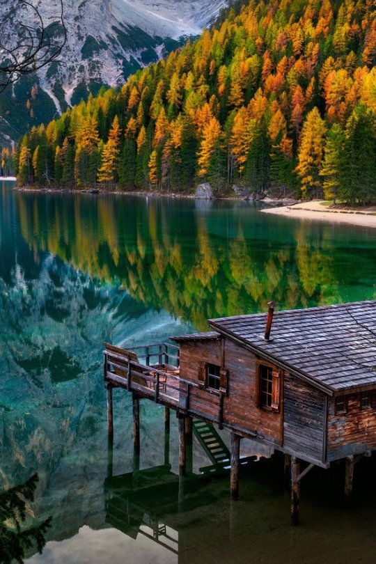 Beautiful Lake house view with the autumn trees and mountains