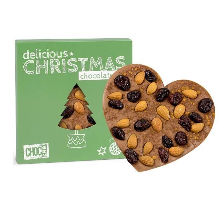 CZEKOLADA MLECZNA Z ŻURAWINĄ    Wyjątkowo świąteczną czekoladę w kształcie serca wykonaną z mlecznej czekolady przyozdobiliśmy migdałami i żurawiną, całość posypaliśmy aromatycznym cynamonem. Czekoladę została opakowana w wyjątkowe świąteczne opakowanie.