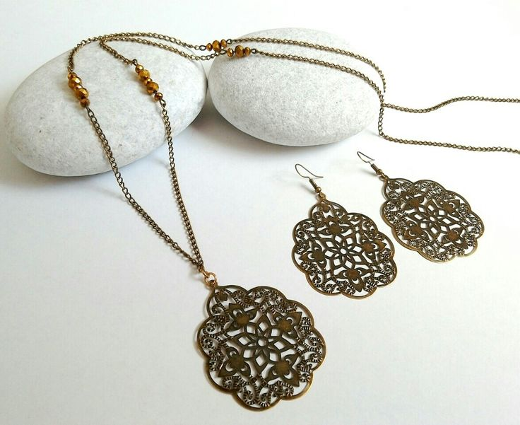 Long bronze chain necklace with filigree charm and filigree bronze earrings. https://m.facebook.com/ElitasBijoux?ref=hl&__nodl