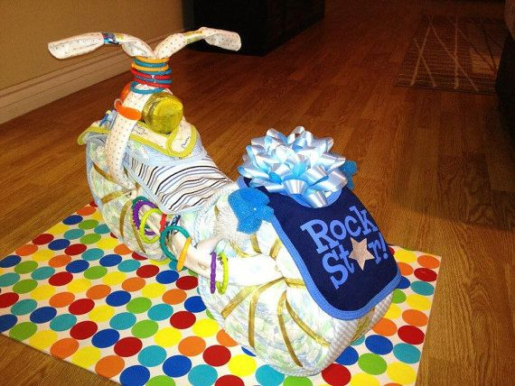 Welcome to GiftyCreations4You...  Please read all the descriptions carefully before placing an order as this is a custom and non-refundable piece.  // DESCRIPTION //  The coolest looking Motorcycle Diaper Cake yet! This will be the talk of the party! This diaper cake centerpiece is made to order. Great for baby shower gift for that baby boy or girl. You will definitely be the envy of the baby shower party because you have the best baby shower diaper cake of them all! &#x2F...