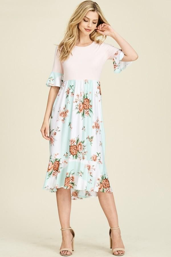 0e6e9c2d455b6 DESCRIPTION: New arrival Floral and solid color block dress featuring  cropped bell sleeve, causal mermaid hem detailing at the bottom skirt on  our signature ...