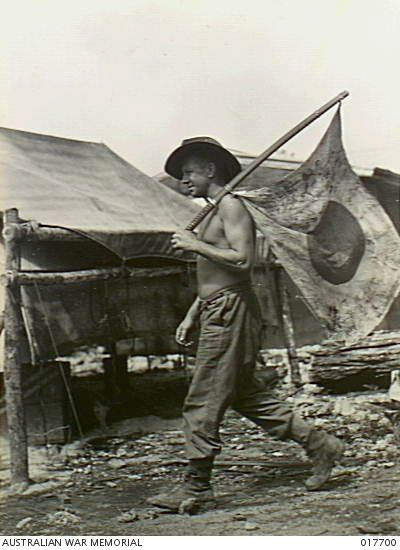 New Guinea. 16 October 1944. This Japanese flag was captured by Leading Aircraftman Roy Cardwell of Oaklands, Tas, from a Japanese officer whom he killed at Noemfoor, Dutch New Guinea. 017700