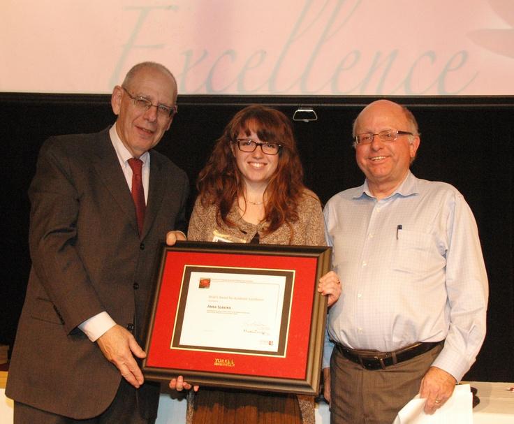 Anna Slavina, winner of the Dean's Award for Academic Excellence, with Dean MArtin Singer, left, and Associate Dean Gary Spraakman.