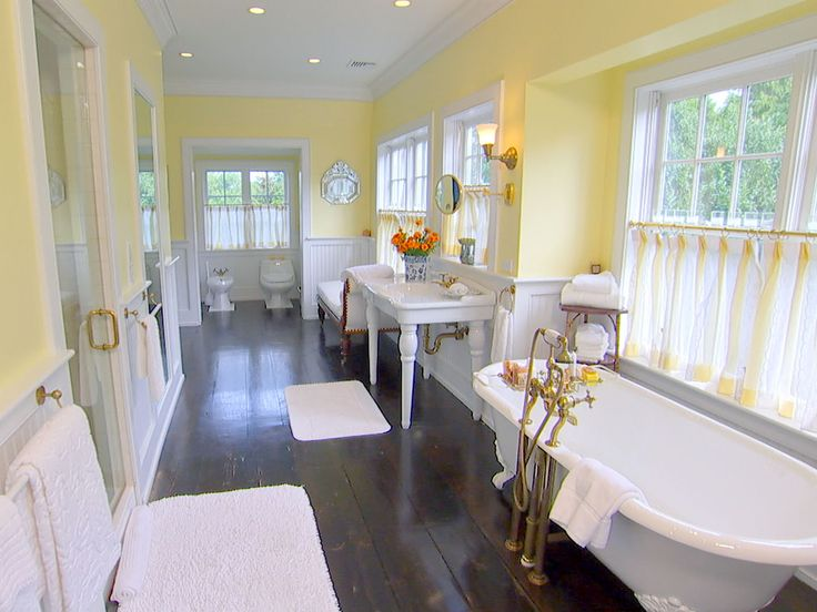 Photo Gallery For Website yellow bathroom decor wit white wainscoting and dark hardwood floor such a great Farmhouse look