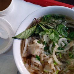 Luu's Baguette - From left to right: Vietnamese coffee (hot), and pho (the meat combo, cooked) -  134 E 26th St - 212.679.8881
