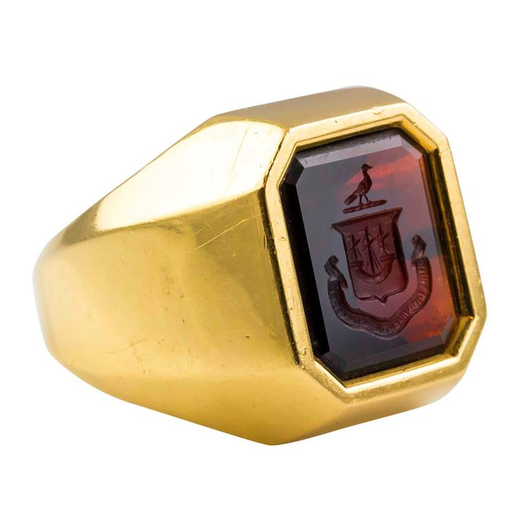 1960s Tiffany & Co. Garnet Crest Signet Signet Ring | From a unique collection of vintage signet rings at http://www.1stdibs.com/jewelry/rings/signet-rings/