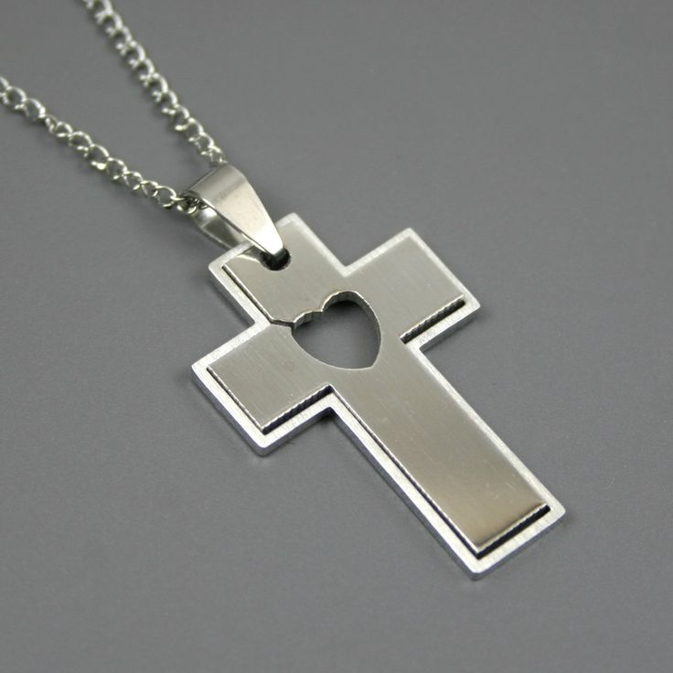 Stainless steel cross pendant with heart cut-out on stainless steel chain