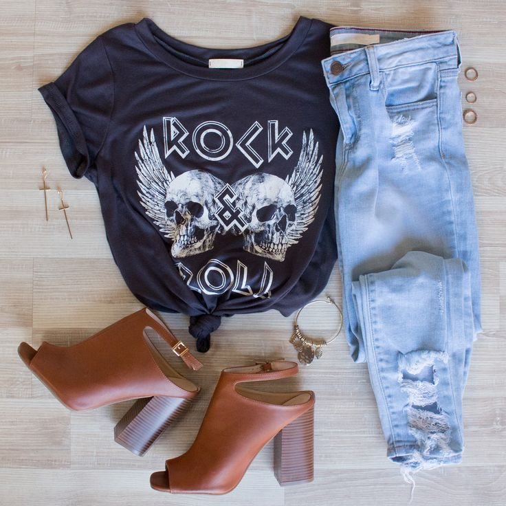 Rock the coliseumstage in the Celine Rock & Roll Top! This amped up tee features a soft fabric with front graphic for bold attitude. Finished hem. Pair with sleek lace up pants and black heels to top it off!