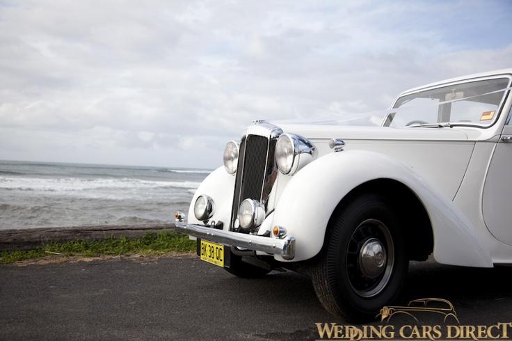 Dolly, the 1947 DB18 Daimler sedan wedding car having her photograph taken at Collaroy Beach, Sydney.