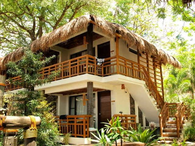 I love their structures which incorporate local materials like bamboo and cogon (Imperata cylindrica) for the roof. Mixed with concrete they look very pleasant, and feel so hospitable. Located in the Acuaverde Resort The Philippines.