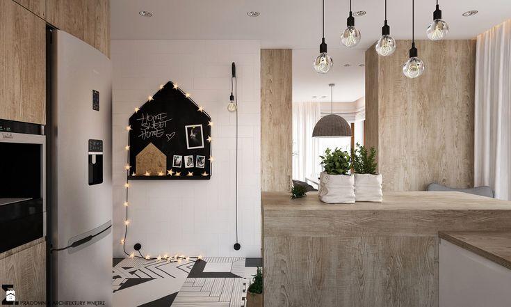 Dekoracyjna tablica w aranżacji kuchni