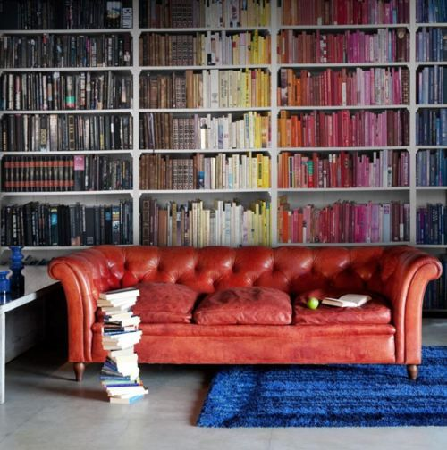 """Not allowed to hang on the walls of your new apartment? Start collecting books now in different colors and stack them up on a book case so you have your own little piece of """"art"""" OR wrap cheap discount books you find online in different wallpapers or papers of different hues."""