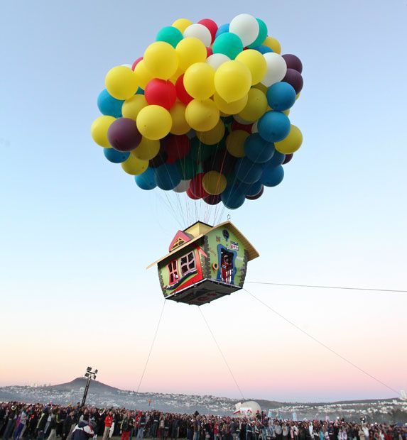 """Like the Pixar/Disney movie """"UP,"""" adventurer Jonathan Trappe launched his own colorful house into the sky. (photo: Laurentiu Garofeanu / Barcroft USA)"""