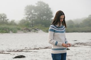Pretty bands of colorwork with a Scandinavian feel are the star components of Dianna Walla's Dalis pullover. This seamless sweater is worked from the bottom up in five colors of worsted weight Lark.