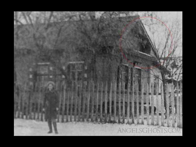 http://www.angelsghosts.com/russian-house-eaves-ghost  We do not have the story behind this ghost photo, but you have to be intrigued to see half a man's body sitting up on a house! Ghost? Double-exposure?
