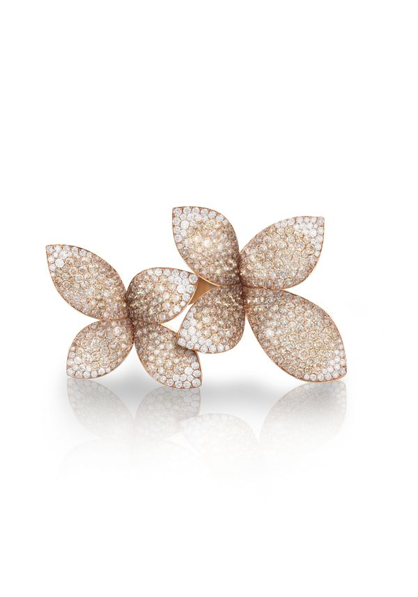 These flower earrings evoke the beauty of nature and elegance of white diamonds - via National Jeweler