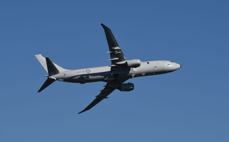 P-8A Poseidon A47-001 climbing past Mt Ainslie after flypast over RAAF national memorial on ANZAC Parade, Canberra on RAAF's 96th birthday.