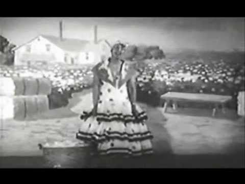 "Ethel Waters sings Am I Blue from the 1929 motion picture ""On With the Show"". This was the first sound movie filmed in color-unfortunately, only black and white copies survive. Also co-starring with Waters in this film are Betty Compson, Arthur Lake and Joe E. Brown. In the second half of the clip, Ms.Waters is accompanied by The Four Emperors of Harmony. The song would become her signature."