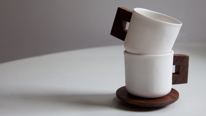 Porcelain and walnut espresso cups  by Merge Ware, Inc.