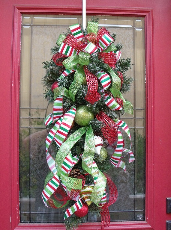 Door swag with cascading ribbonsSwag Ribbons, Christmas Wreaths, The Doors, Ribbons Cascading, Christmas Front Doors, Christmas Swag, Wreaths Vertical, Christmas Decor, Christmas Door