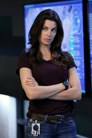 Agent Riley Neal from Intelligence, played by Meghan Ory.