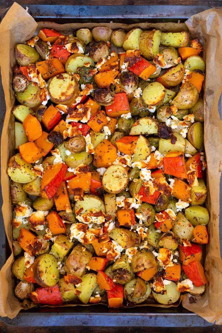 Baked potatoes with pumpkin, Brussels sprouts and feta
