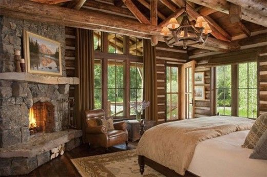 Dormitorio rustico con hogar a leña