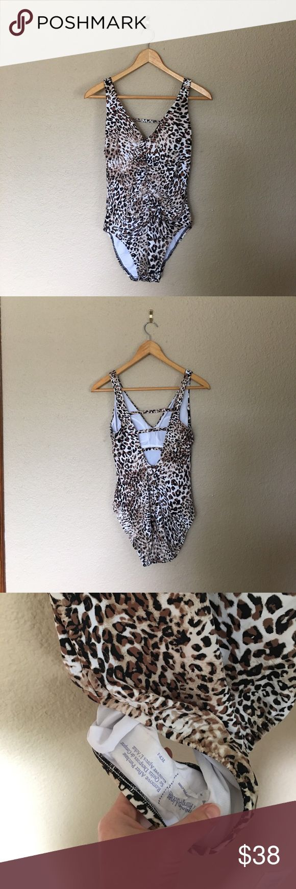 NWT Leopard Animal Print Strappy One Piece Ruched Beautiful one piece with hygienic liner in tact. Lightly padded and fully lined. Brand is aqua Green. aqua green Swim One Pieces