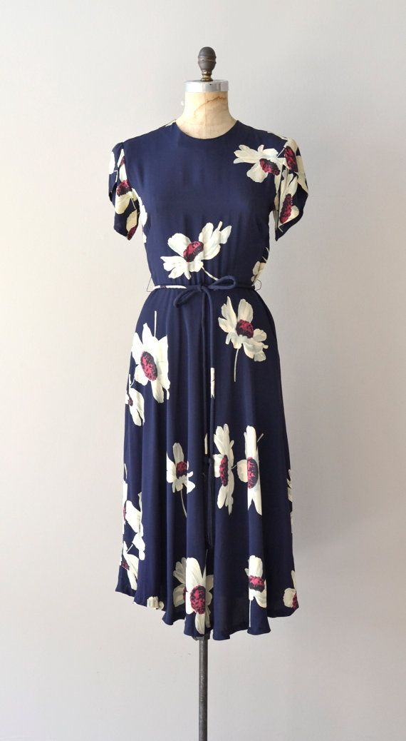 1940s dress at Dear Golden navy blue rayon dress with large floral print, short split sleeves, double bust darts, fitted waist, tie belt with long tassels