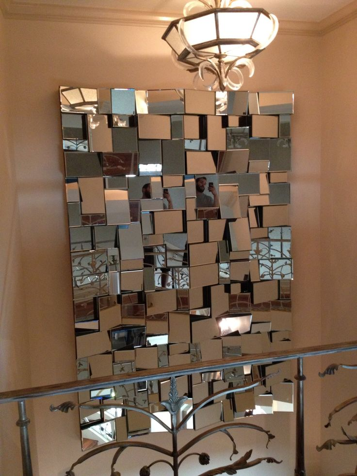 2nd story penthouse mirror installation for hm design downtown san diego