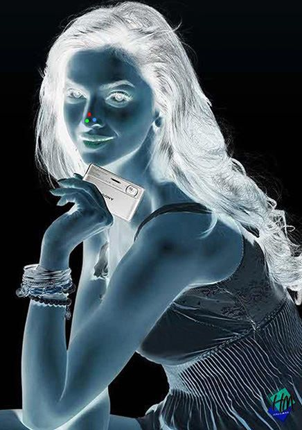 Open this up (so it's larger), and stare at the three nose-dots for 30 seconds. Then look at a white wall and blink a lot. She turns into color! Congratulations, you have just developed a negative with your brain.