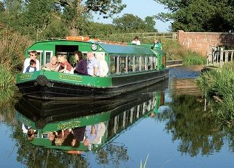 Our electrically powered boat, Wiggonholt, is wider than a conventional narrowboat and can accommodate up to 50 passengers. It has an access lift for passengers with mobility difficulties.