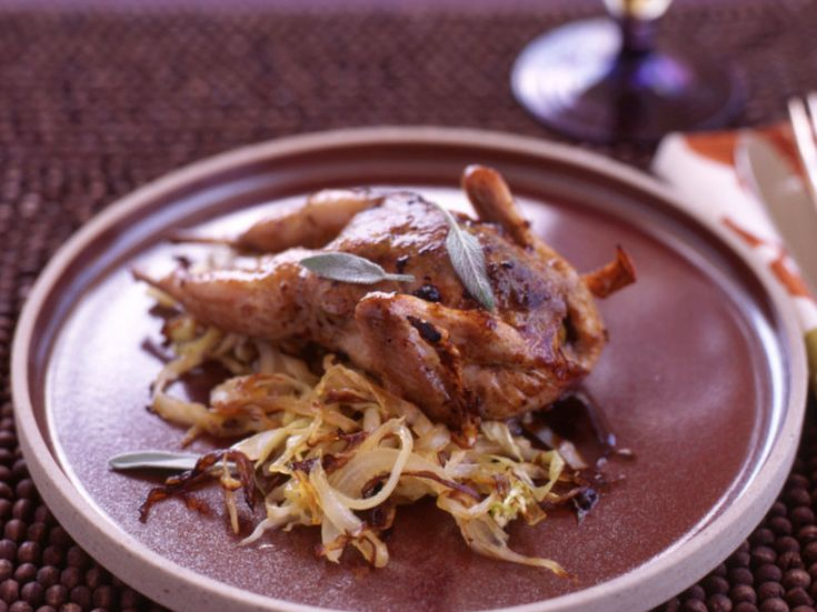 Roasted Quail with Cabbage and Raisins | Food & Wine goes way beyond mere eating and drinking. We're on a mission to find the most exciting places, new experiences, emerging trends and sensations.